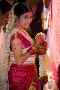 Candid Indian Wedding - Bride holding garland